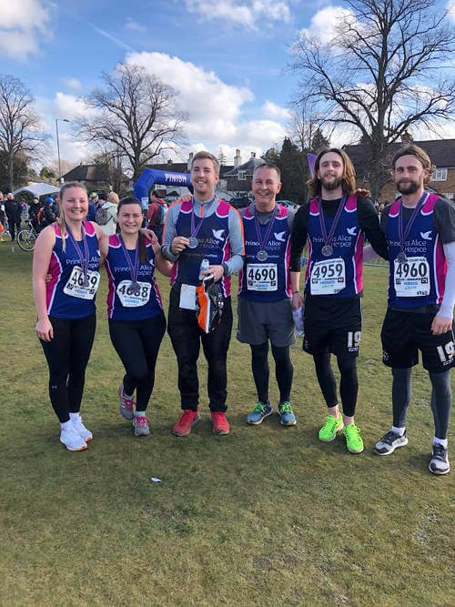 fieldmans-access-floors-employees-with-medals-for-completing-hampton-court-half-marathon