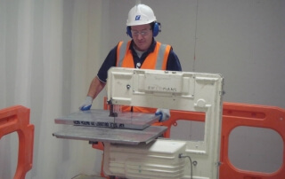 fieldmans-worker-using-machinery-to-cut-floor-panel