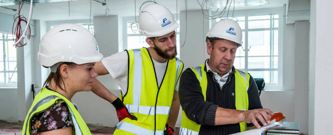 Fieldmans-staff-discussing-raised-flooring-project(1)