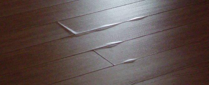 vinyl-floor-tiles-lifting-due-to-heat-damage